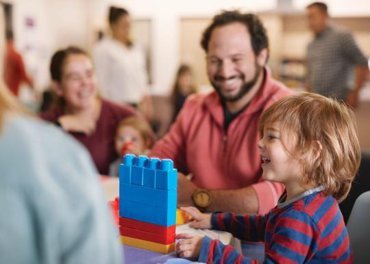 Father and child enjoying family night with building blocks