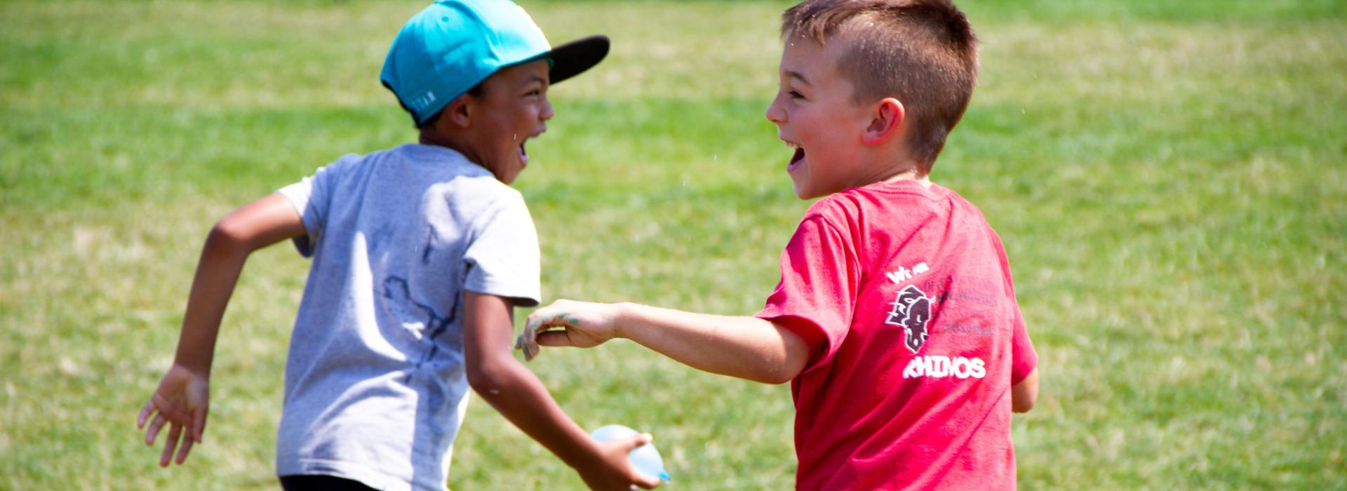 Water Balloon Fight At Summer Day Camp